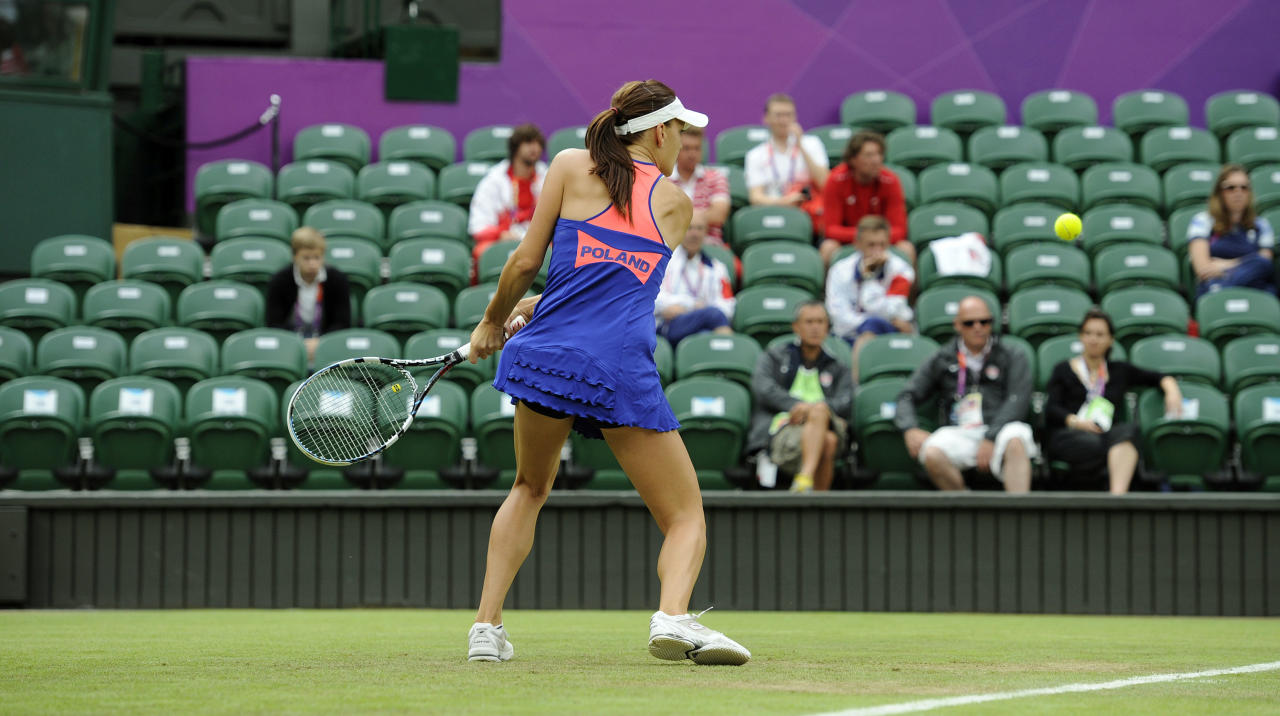 Poland's Agnieszka Radwanska prepares to return to Julia Goerges of Germany during their match at the All England Lawn Tennis Club in Wimbledon, London at the 2012 Summer Olympics, Sunday, July 29, 2012. (AP Photo/Rebecca Naden, PA) UNITED KINGDOM OUT