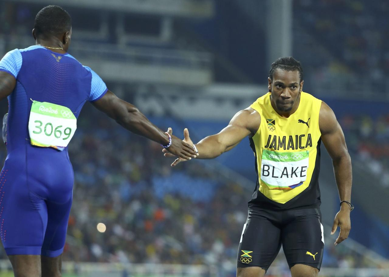 2016 Rio Olympics - Athletics - Semifinal - Men's 200m Semifinals - Olympic Stadium - Rio de Janeiro, Brazil - 17/08/2016. Justin Gatlin (USA) of USA (L) and Yohan Blake (JAM) of Jamaica. REUTERS/Lucy Nicholson  FOR EDITORIAL USE ONLY. NOT FOR SALE FOR MARKETING OR ADVERTISING CAMPAIGNS.