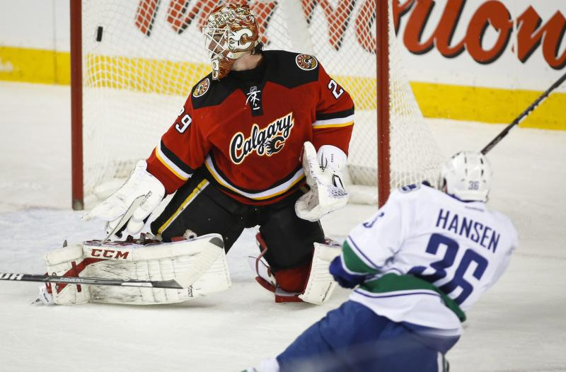 Lack makes 18 saves as Canucks blank Flames 2-0