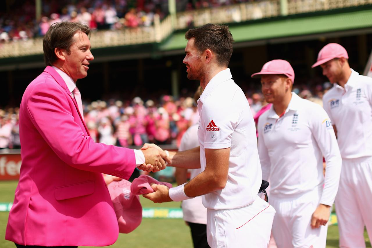 SYDNEY, AUSTRALIA - JANUARY 05: James Anderson of England presents a pink cap to former Australian cricketer Glenn McGrath on Jane McGrath Day during day three of the Fifth Ashes Test match between Australia and England at Sydney Cricket Ground on January 5, 2014 in Sydney, Australia.  (Photo by Cameron Spencer/Getty Images)
