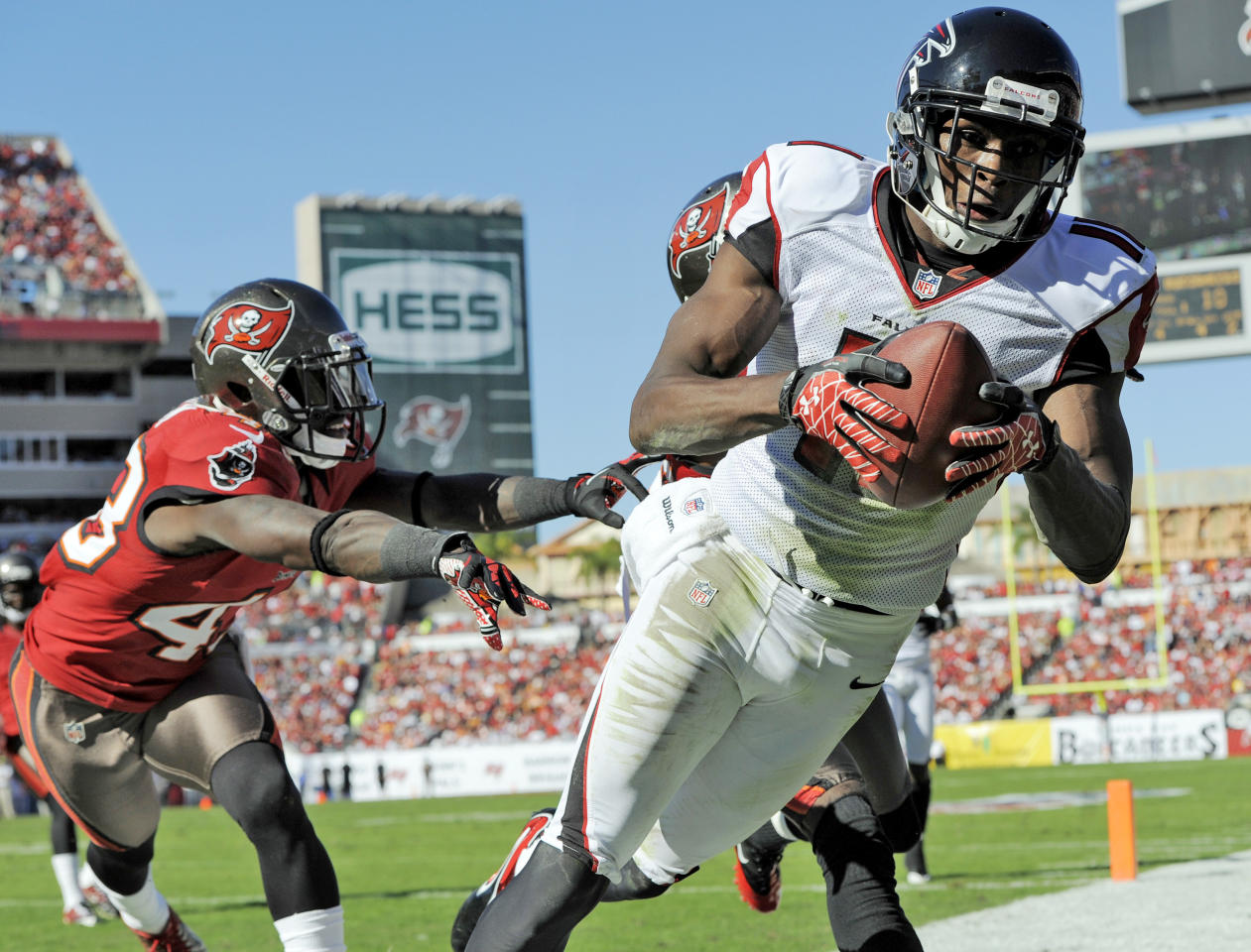 Atlanta Falcons wide receiver Julio Jones (11) is shoved out of bounds by Tampa Bay Buccaneers free safety Ahmad Black (43) during the second quarter of an NFL football game Sunday, Nov. 25, 2012, in Tampa, Fla. Jones was ruled out of bounds. (AP Photo/Brian Blanco)