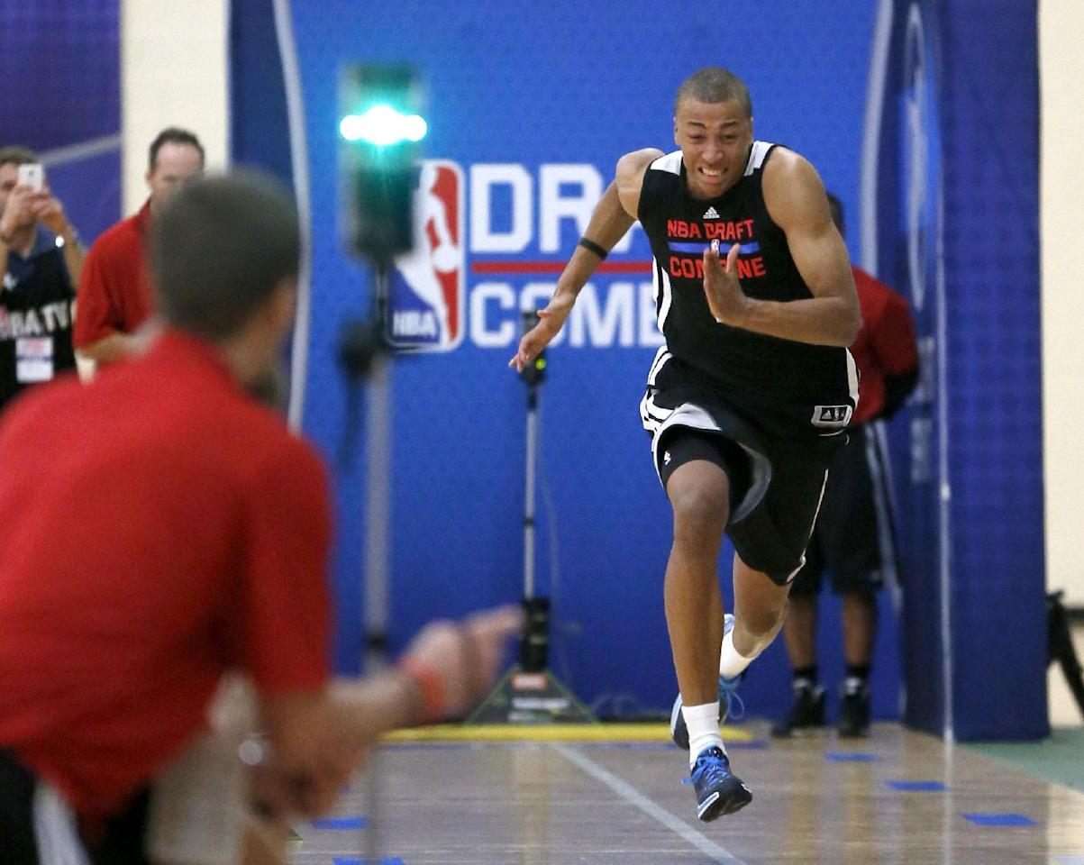 Dante Exum, from Australia, participates in the three-quarters-court sprint in the 2014 NBA basketball draft combine Friday, May 16, 2014, in Chicago. (AP Photo/Charles Rex Arbogast)