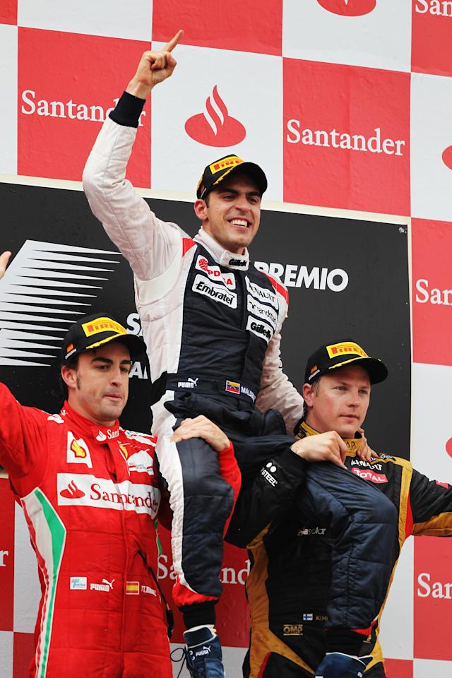 BARCELONA, SPAIN - MAY 13:  Race winner Pastor Maldonado (C) of Venezuela and Williams celebrates on the shoulders of second placed Fernando Alonso (L) of Spain and Ferrari and third placed Kimi Raikkonen (R) of Finland and Lotus following the Spanish Formula One Grand Prix at the Circuit de Catalunya on May 13, 2012 in Barcelona, Spain.  (Photo by Mark Thompson/Getty Images)