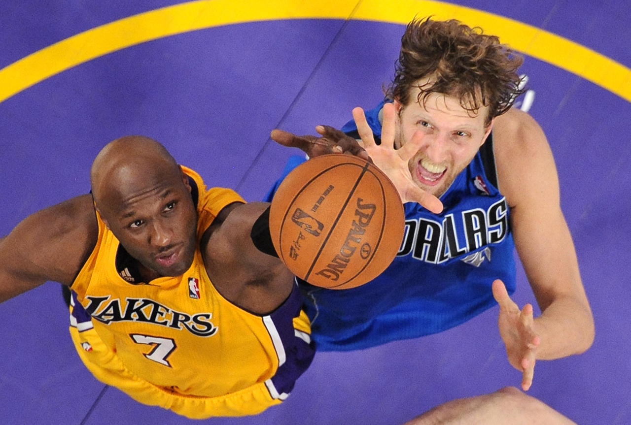 Los Angeles Lakers forward Lamar Odom, left, and Dallas Mavericks forward Dirk Nowitzki of Germany go after a rebound during the second half in Game 2 of a second-round NBA playoff basketball series, Wednesday, May 4, 2011, in Los Angeles. The Mavericks won 93-81.