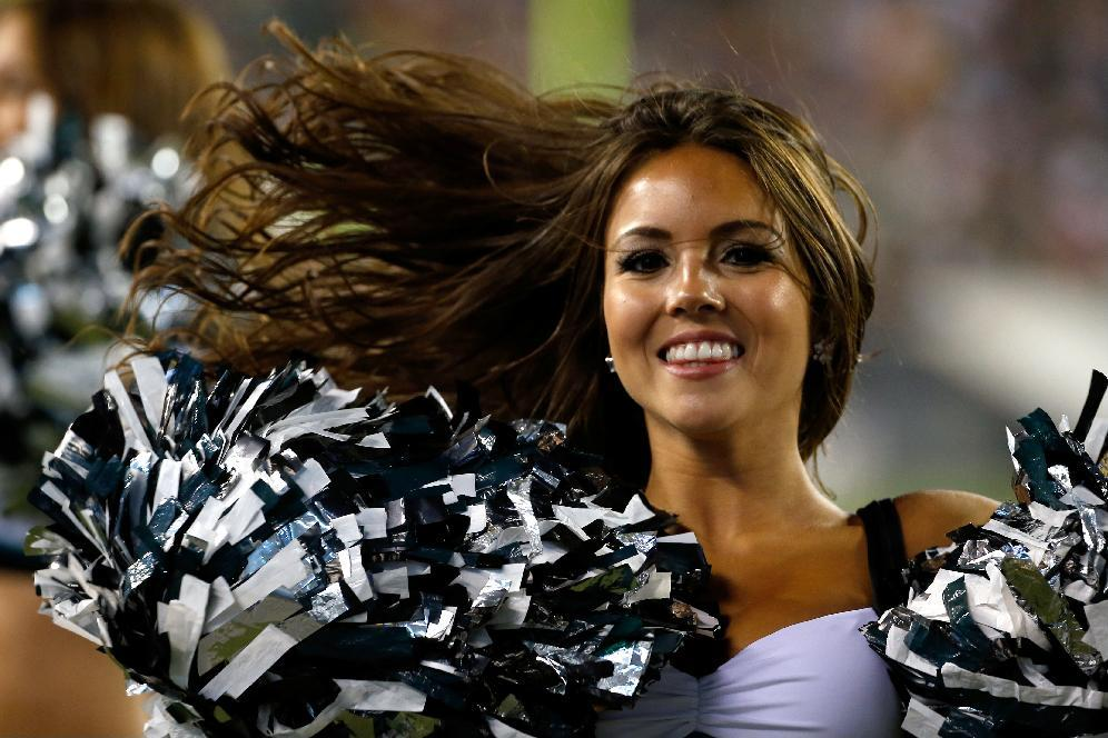 A Philadelphia Eagles cheerleader performs during the first half of an NFL preseason football game against the New York Jets, Thursday, Aug. 28, 2014, in Philadelphia. (AP Photo/Michael Perez)