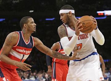 Carmelo Anthony, right, plans to become a free agent July 1. (AP Photo)