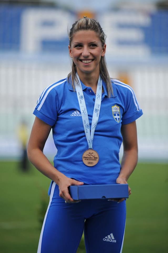 Bronze medalist Paraskevi Papachristou of Greece poses for the photographers after the Women's Triple Jump Final during the XVI Mediterranean Games on July 3, 2009 in Pescara, Italy. (Photo by Getty Images)