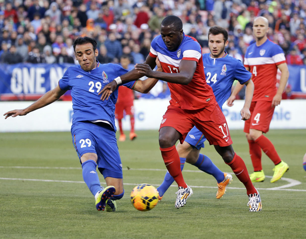 United States' Jozy Altidore (17) tries to dribble around Azerbaijan's Elvin Yunuszade (29) during the first half of an international friendly soccer match on Tuesday, May 27, 2014, in San Francisco. (AP Photo/Marcio Jose Sanchez)