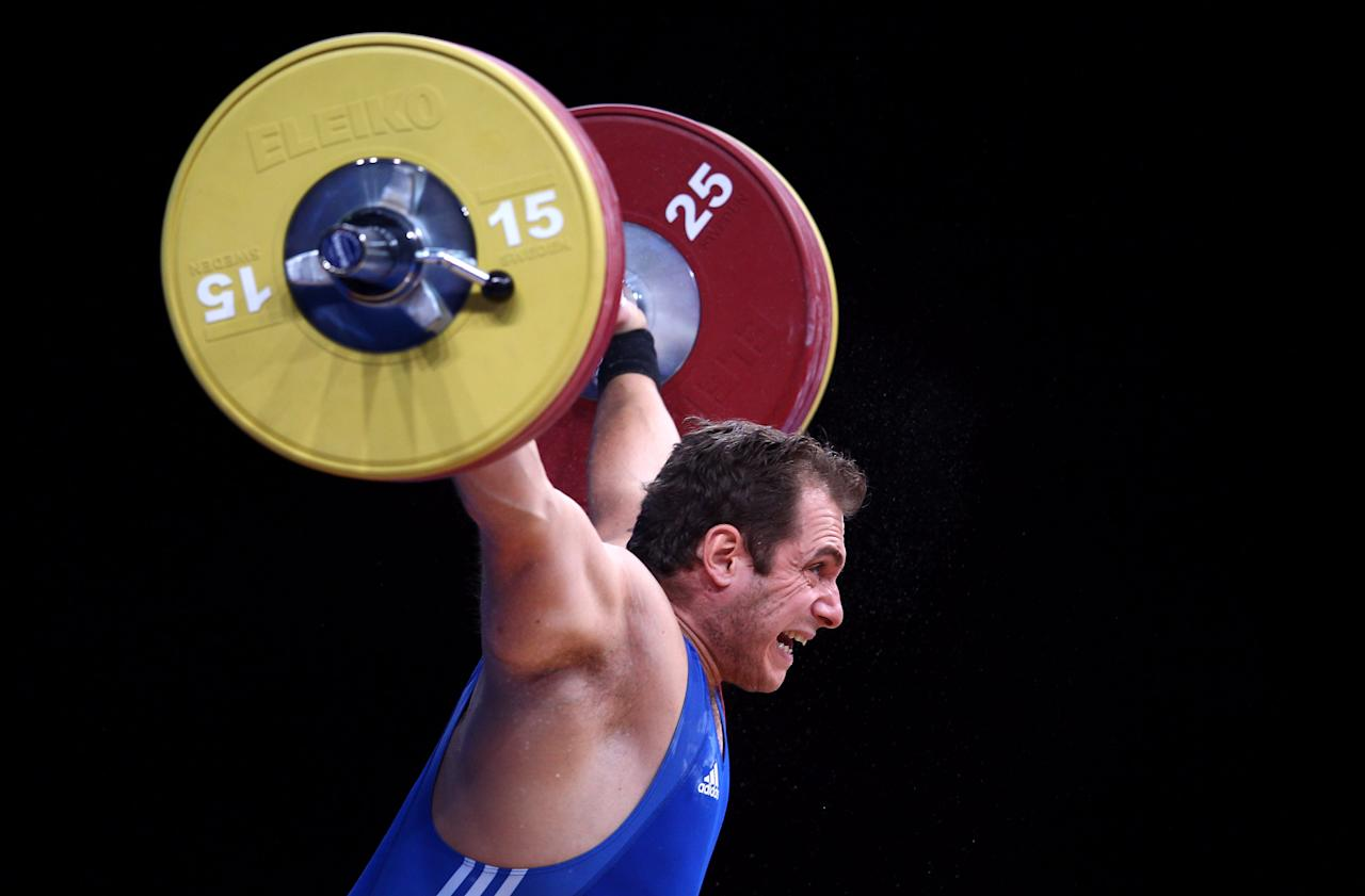 LONDON, ENGLAND - DECEMBER 11: Kevin Bouly of France makes a lift in the Men's 105kg during the Weightlifting LOCOG Test Event for London 2012 at ExCel on December 11, 2011 in London, England. (Photo by Julian Finney/Getty Images)