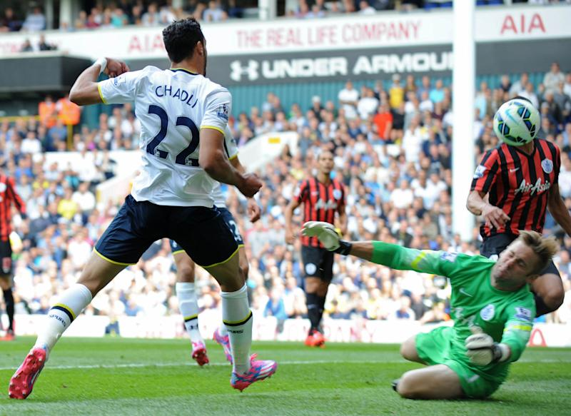 Tottenham Hotspur's Belgian midfielder Nacer Chadli (L) scores the opening goal past Queens Park Rangers' English goalkeeper Robert Green during the English Premier League football match in north London on August 24, 2014