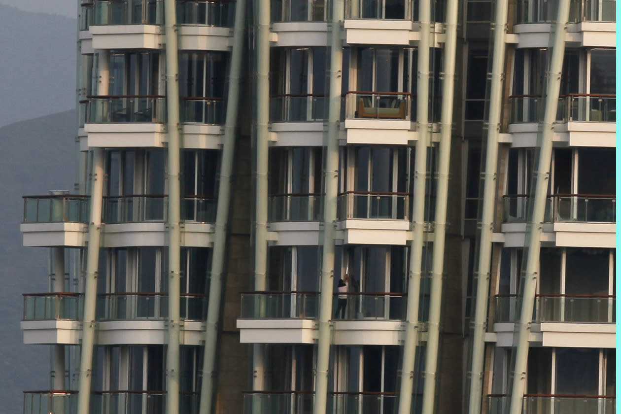 "A worker cleans a window at the luxury residential building ""Opus Hong Kong,"" designed by Frank Gehry in Mid-Levels East of Hong Kong"