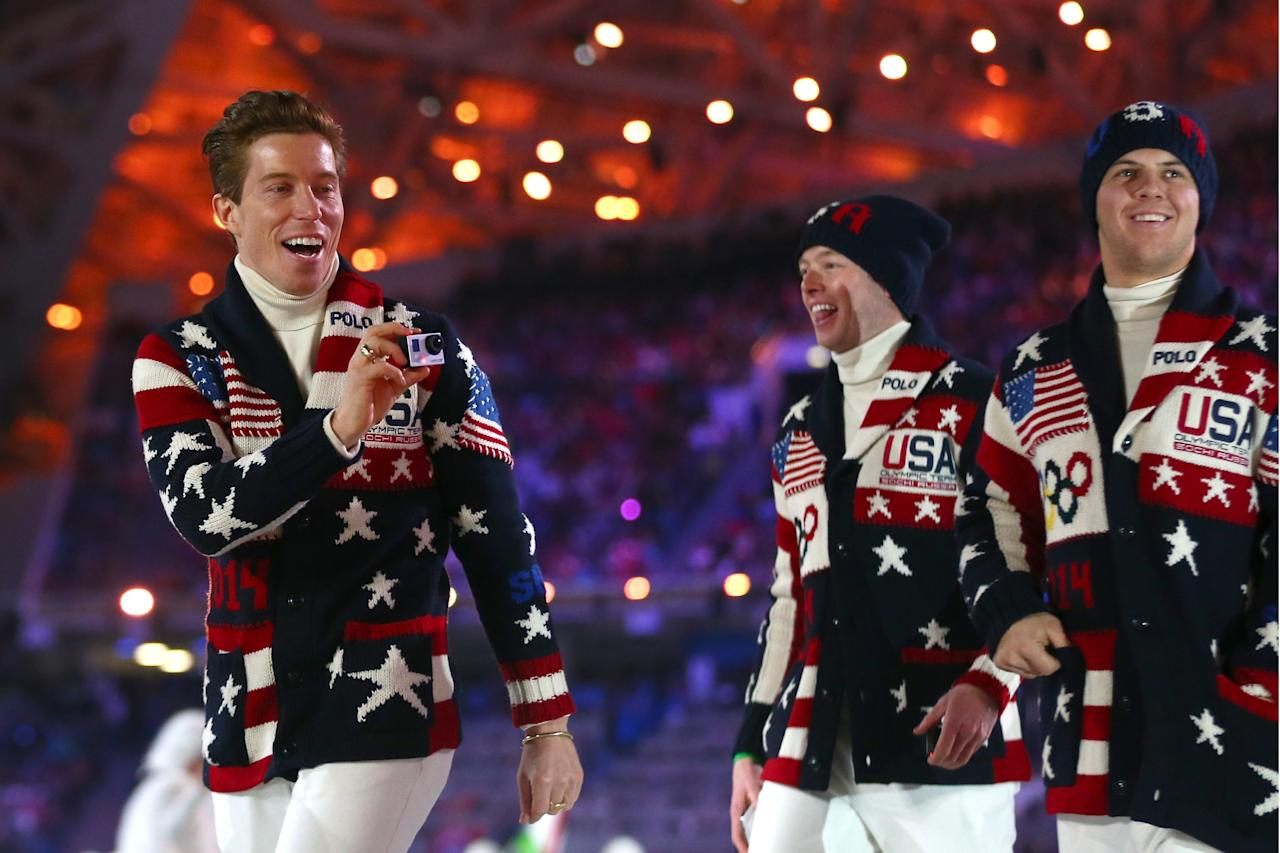 SOCHI, RUSSIA - FEBRUARY 07: Snowboarder Shaun White (L) enters the stadium with the United States Olympic team during the Opening Ceremony of the Sochi 2014 Winter Olympics at Fisht Olympic Stadium on February 7, 2014 in Sochi, Russia. (Photo by Ryan Pierse/Getty Images)