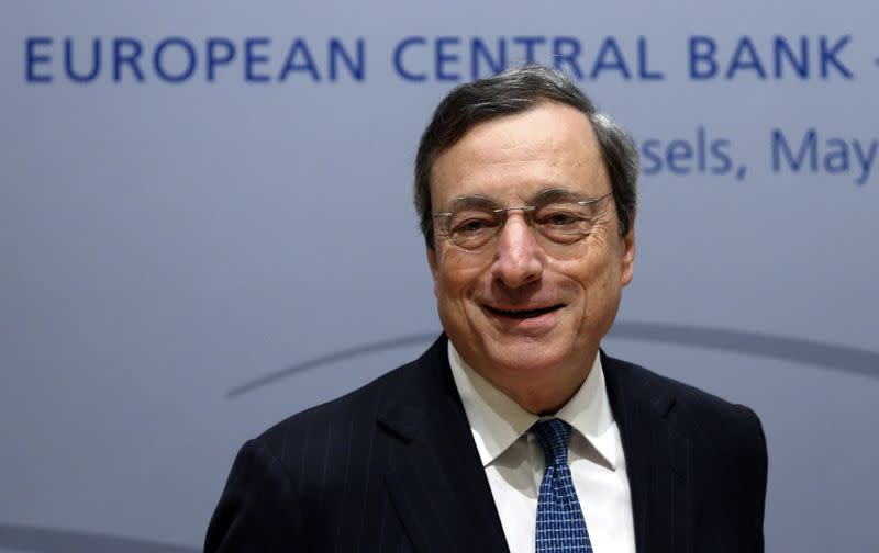 ECB President Draghi arrives at a news conference in Brussels
