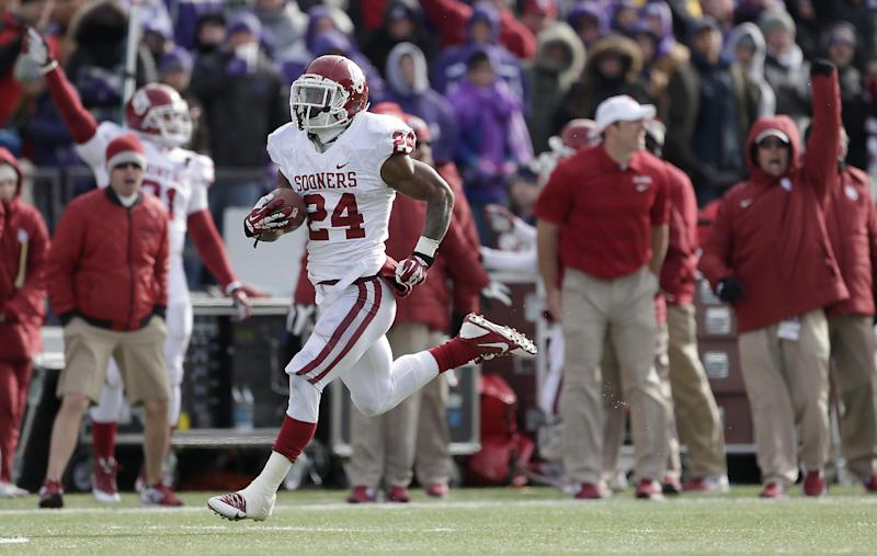 No. 22 Sooners beat K-State to give Stoops record