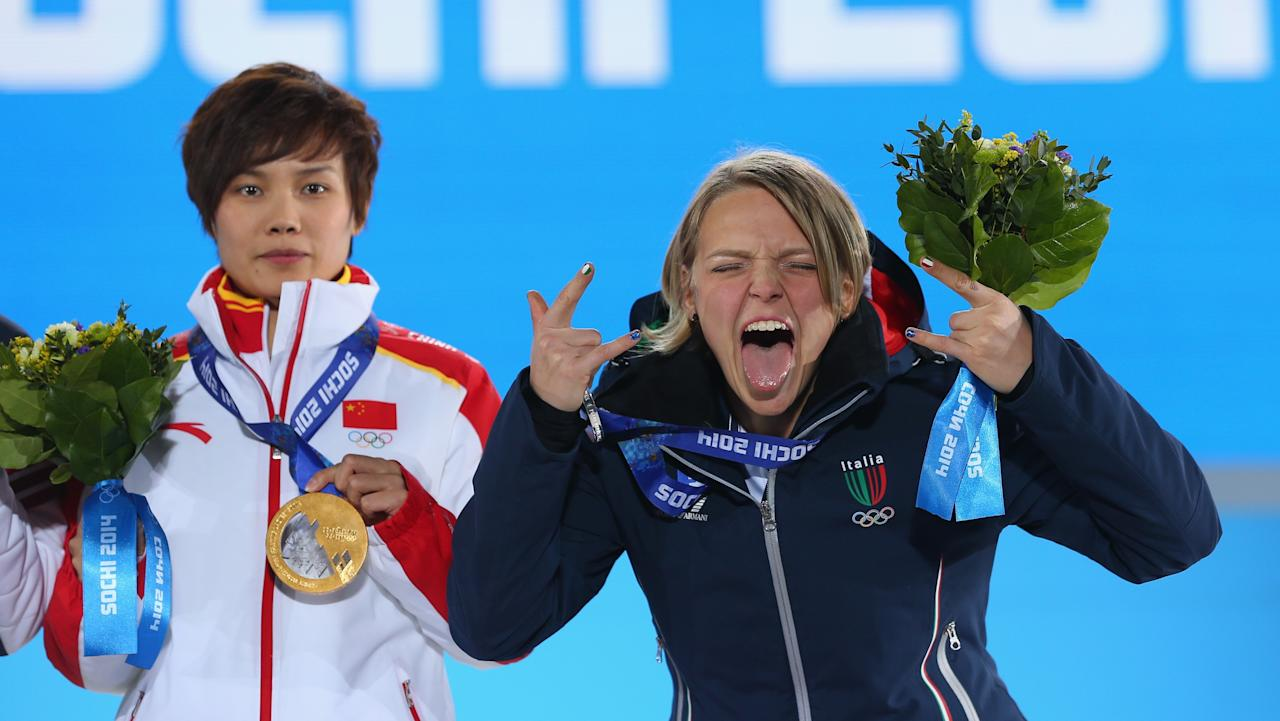SOCHI, RUSSIA - FEBRUARY 13: (L-R) Gold medalist Jianrou Li of China and silver medalist Arianna Fontana of Italy celebrate during the medal ceremony for the Short Track Speed Skating Ladies' 500 m on day six of the Sochi 2014 Winter Olympics at Medals Plaza on February 13, 2014 in Sochi, Russia. (Photo by Quinn Rooney/Getty Images)