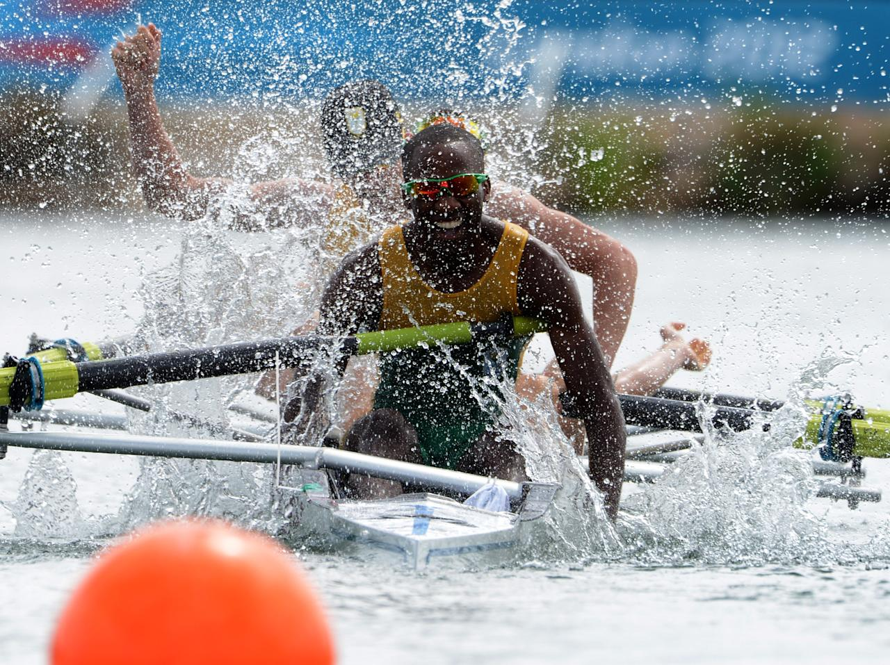 WINDSOR, ENGLAND - AUGUST 02:  Sizwe Ndlovu, John Smith, Matthew Brittain and James Thompson of South Africa celebrate after winning gold in the Lightweight Men's Four final on Day 6 of the London 2012 Olympic Games at Eton Dorney on August 2, 2012 in Windsor, England.  (Photo by Damien Meyer - IOPP Pool /Getty Images)