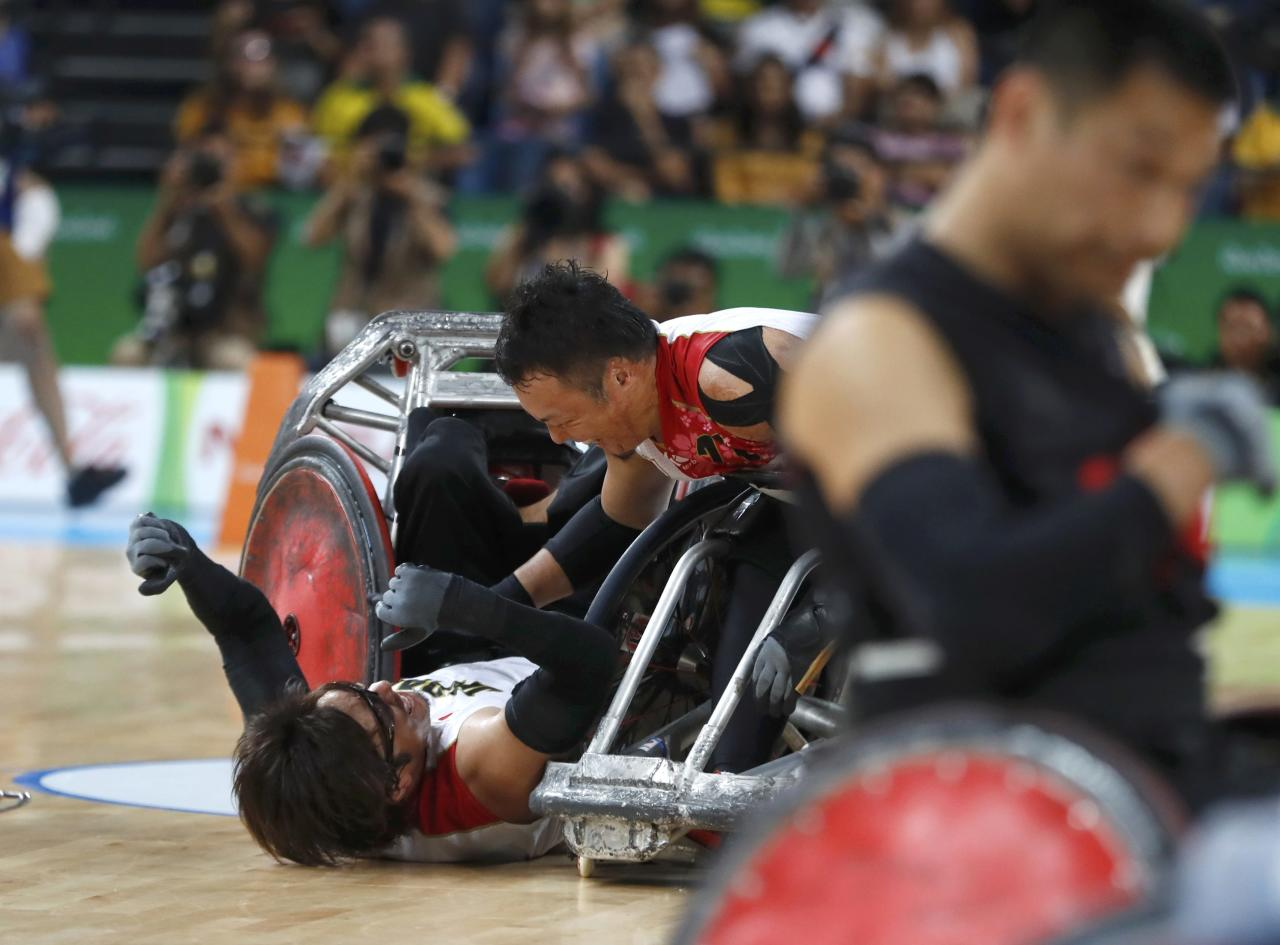 2016 Rio Paralympics - Wheelchair Rugby - Final - Mixed Team Bronze Medal Final - Japan v Canada - Carioca Arena 1 - Rio de Janeiro, Brazil - 18/09/2016. Daisuke Ikezaki (L) and Yukinobu Ike of Japan celebrate winning bronze medals. REUTERS/Carlos Garcia Rawlins  FOR EDITORIAL USE ONLY. NOT FOR SALE FOR MARKETING OR ADVERTISING CAMPAIGNS.