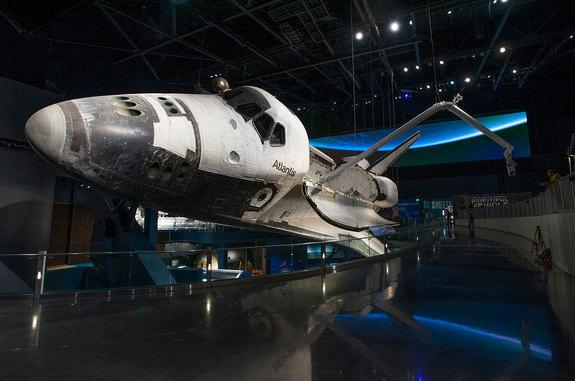 "Space shuttle Atlantis, as displayed inside the new $100 million ""Space Shuttle Atlantis"" exhibit that opened Saturday, June 29, 2013, at NASA's Kennedy Space Center Visitor Complex in Florida."