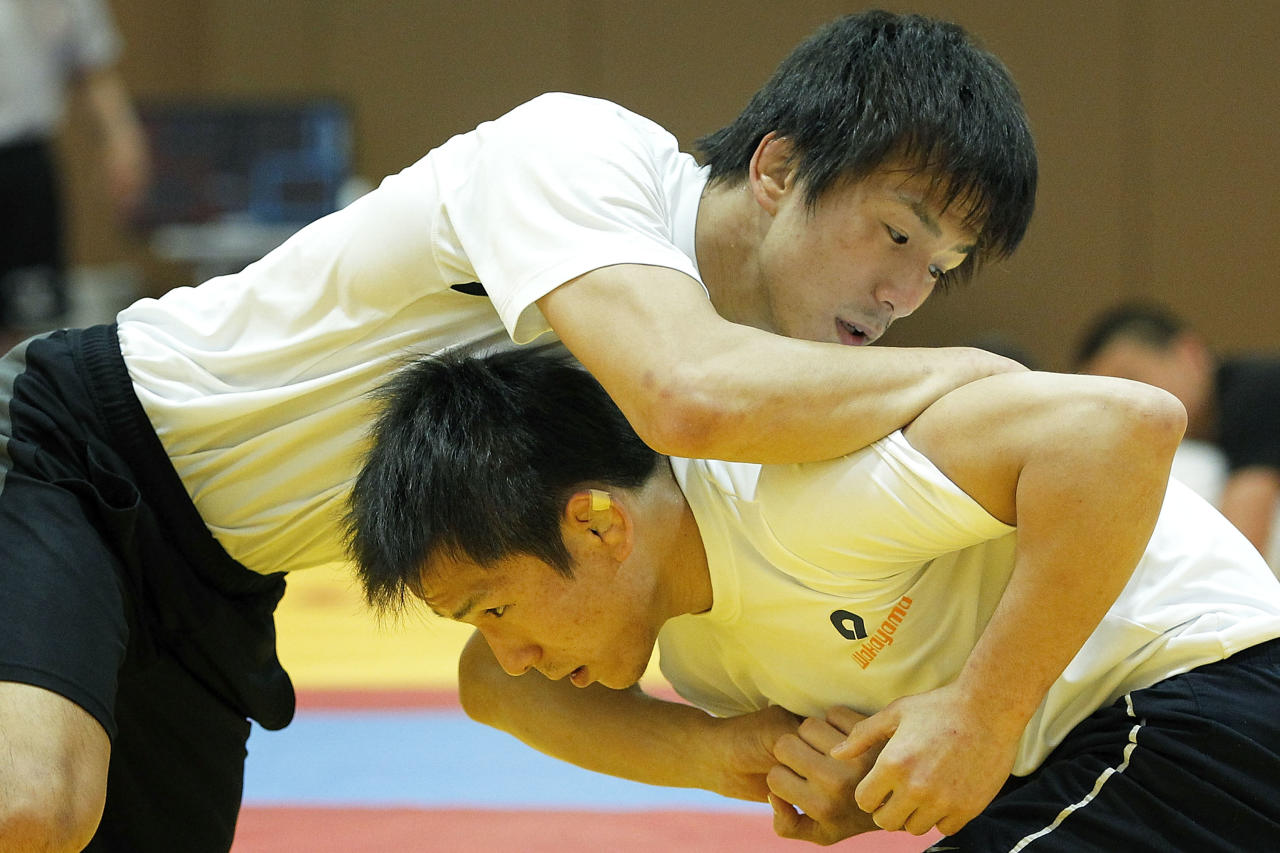 TOKYO, JAPAN - MAY 24:  Kenichi Yumoto (L) and his twin brother Shinichi Yumoto of Japan take part in the training session for the Japan Men's wrestling team for the London 2012 Olympic Games at the National Training Center on May 24, 2012 in Tokyo, Japan.  (Photo by Kiyoshi Ota/Getty Images)