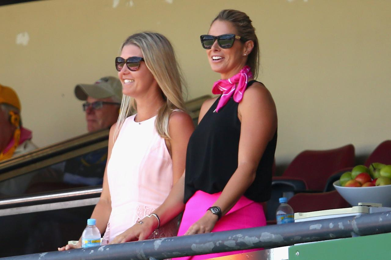 SYDNEY, AUSTRALIA - JANUARY 05:  Candice Falzon (R), Australian Ironwoman and partner of David Warner of Australia, looks on during day three of the Fifth Ashes Test match between Australia and England at Sydney Cricket Ground on January 5, 2014 in Sydney, Australia.  (Photo by Ryan Pierse/Getty Images)