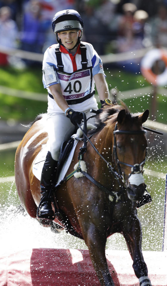 Zara Phillips of Great Britain rides High Kingdom as she competes in the equestrian eventing cross-country phase at Greenwich Park, at the 2012 Summer Olympics, Monday, July 30, 2012, in London. (AP Photo/Markus Schreiber)