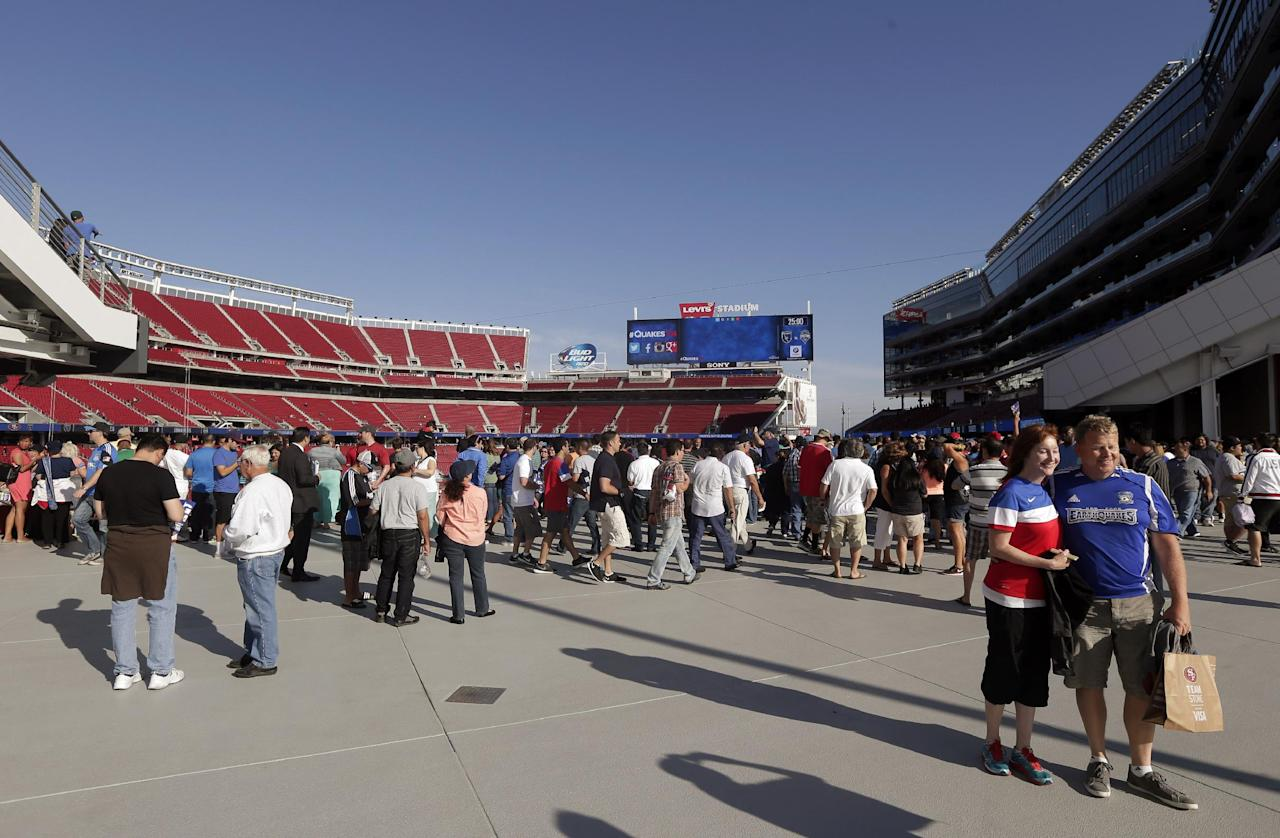 Fans taken in views of the new Levi's Stadium before an MLS soccer match between the San Jose Earthquakes and the Seattle Sounders on Saturday, Aug. 2, 2014, in Santa Clara, Calif. (AP Photo/Marcio Jose Sanchez)