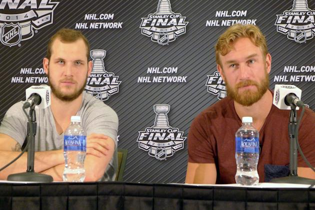 Los Angeles Kings' Kyle Clifford, left, and Jeff Carter take questions from the media at a news conference in El Segundo, Calif., Thursday, June 5, 2014. Los Angeles Kings beat the New York Rangers 3-2 on Wednesday night in the Stanley Cup finals opener. Game 2 is Saturday at Staples Center. (AP Photo/The Canadian Press, Neil Davidson)