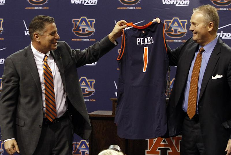 Auburn athletic director Jay Jacobs, right, introduces men's basketball coach Bruce Pearl, as they hold up a jersey on Tuesday, March 18, 2014, in Auburn, Ala