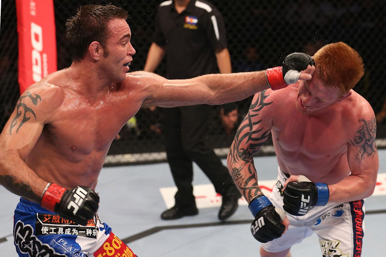 Jake Shields punches Ed Herman during their middleweight bout at UFC 150 inside Pepsi Center on August 11, 2012 in Denver, Colorado. (Photo by Nick Laham/Zuffa LLC/Zuffa LLC via Getty Images)