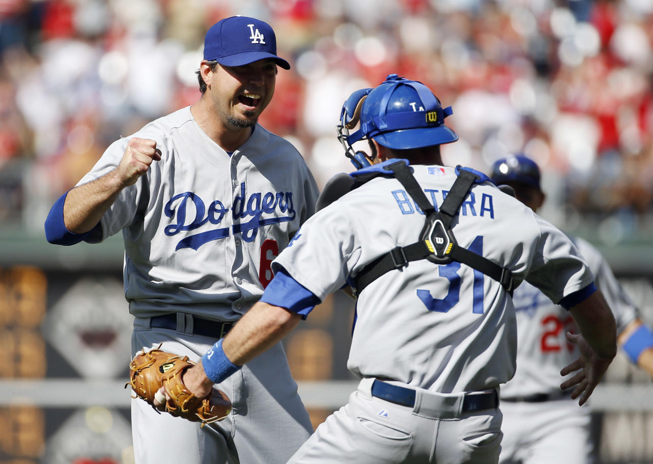 Los Angeles Dodgers starting pitcher Josh Beckett, left, celebrates with catcher Drew Butera after striking out Philadelphia Phillies' Chase Utley looking for a no-hitter baseball game, Sunday, May 25, 2014, in Philadelphia. Los Angeles won 6-0. (AP Photo/Matt Slocum)