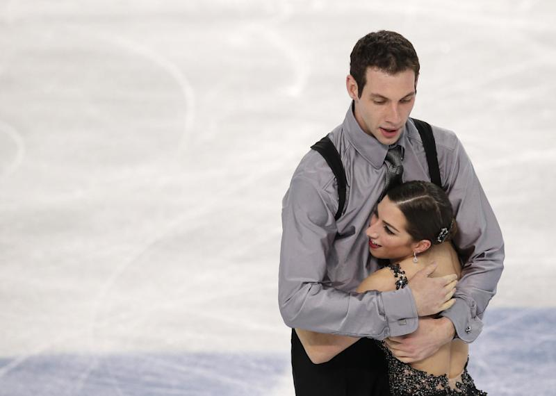 Marissa Castelli and Simon Shnapir of the United States embrace after competing in the pairs free skate figure skating competition at the 2014 Winter Olympics, Wednesday, Feb. 12, 2014, in Sochi, Russia