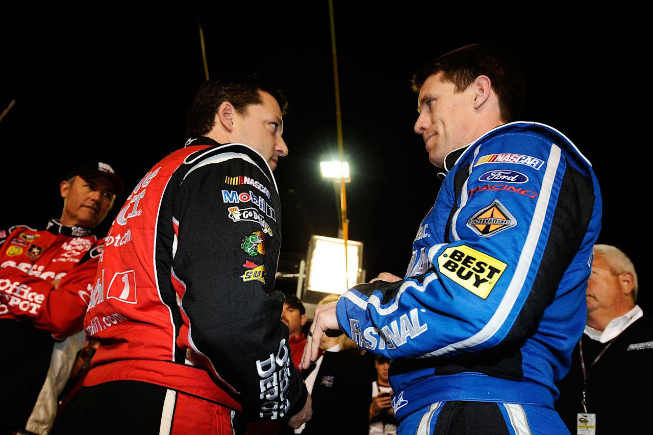 DAYTONA BEACH, FL - FEBRUARY 27:  Carl Edwards, driver of the #99 Fastenal Ford, talks with Tony Stewart, driver of the #14 Office Depot/Mobil 1 Chevrolet, on the grid prior to the start of the NASCAR Sprint Cup Series Daytona 500 at Daytona International Speedway on February 27, 2012 in Daytona Beach, Florida.  (Photo by Jared C. Tilton/Getty Images for NASCAR)