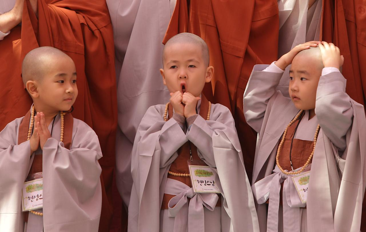 SEOUL, SOUTH KOREA - MAY 03:  Children attend the 'Children Becoming Buddhist Monks' ceremony forthcoming buddha's birthday at a Chogye temple on May 3, 2013 in Seoul, South Korea. The children will stay at the temple to learn about Buddhism for 14 days. Buddha was born approximately 2,557 years ago, and although the exact date is unknown, Buddha's official birthday is celebrated on the full moon in May in South Korea, which is on May 17 this year.  (Photo by Chung Sung-Jun/Getty Images)