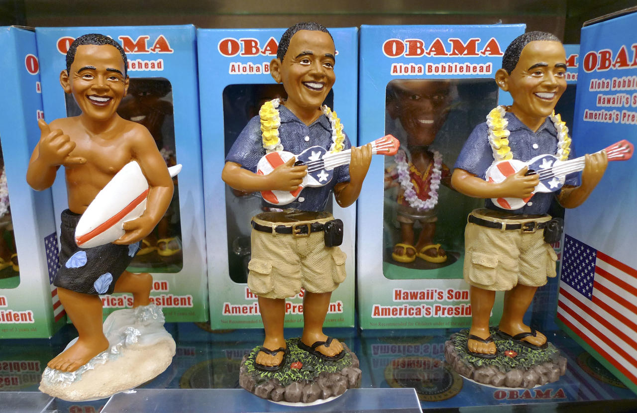 U.S. President Barack Obama Aloha Bobblehead Dolls are displayed for sale in the Waikiki Beach area of Honolulu, Hawaii, December 27, 2009. REUTERS/Larry Downing