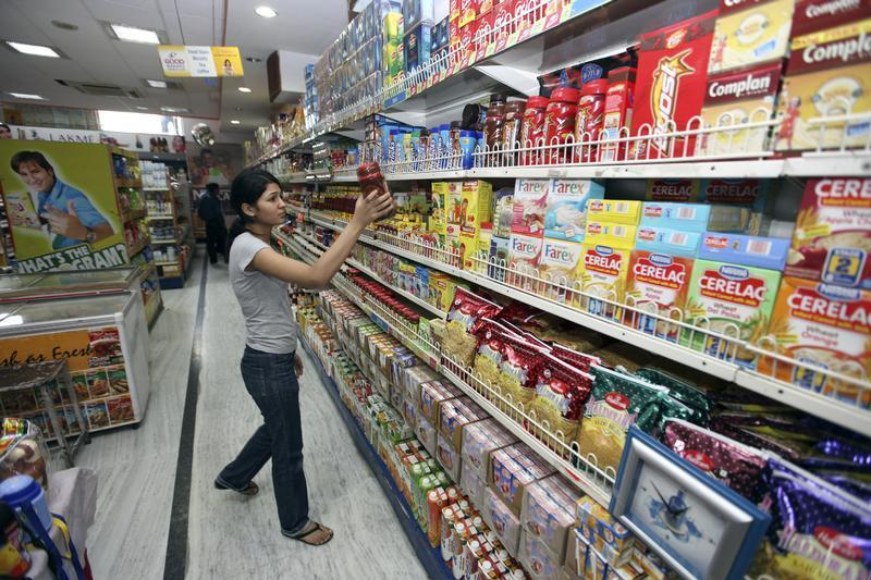A customer shops at a grocery store in Lucknow