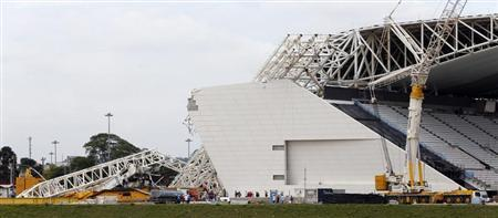 """A general view shows a collapsed crane at the Arena Sao Paulo stadium, known as """"Itaquerao"""", in Sao Paulo"""