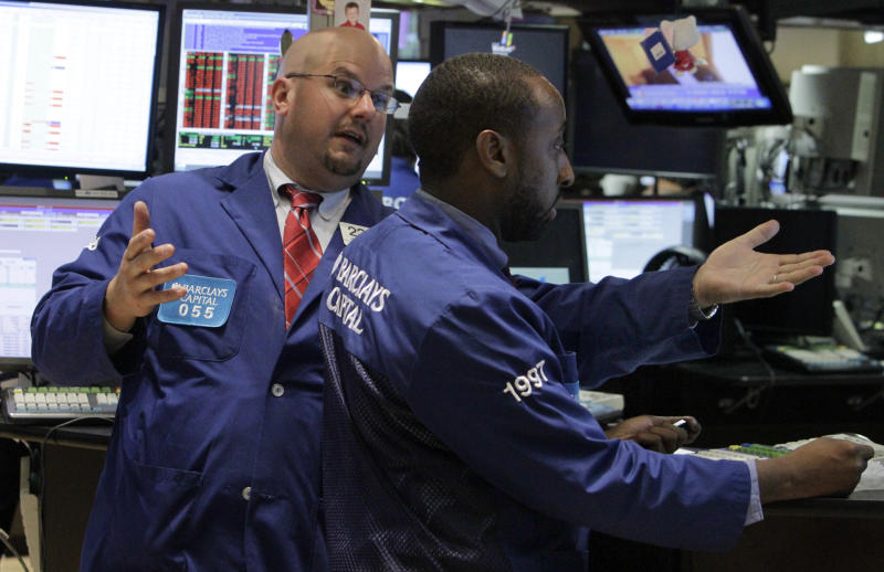 Stocks fall on news Fed weighed cutting stimulus