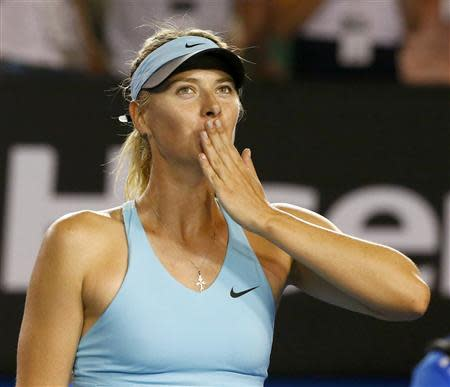 Maria Sharapova of Russia blows kisses to the crowd after defeating Bethanie Mattek-Sands of the United States in their women's singles match at the Australian Open 2014 tennis tournament in Melbourne