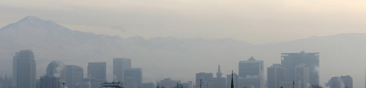 Smog from an inversion hangs over downtown Salt Lake City Wednesday, Jan. 23, 2013. The geography that makes Utah one of the worldís most beautiful places also brings the nationís dirtiest air in winter, when an icy fog smothers mountain valleys for days or weeks at a time. A group of doctors is declaring a health emergency over northern Utah's lingering pollution problem. Utah Physicians for a Healthy Environment planned to deliver a petition Wednesday demanding immediate action by elected officials. The group wants Gov. Gary Herbert and mayors of northern Utah cities to cut the pollution. (AP Photo/Rick Bowmer)