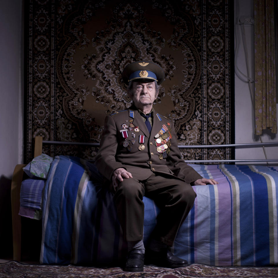 In this photo made on Friday, April 12, 2013, Soviet Jewish World War veteran Aharon Kavishaner poses for a portrait at his house in the southern Israeli city of Ashkelon. Kavishaner joined the Red Army in 1942, as an air force mechanic and served in the 4th Ukrainian Front, a Soviet army group. Kavishaner immigrated to Israel in 1991. About 500,000 Soviet Jews served in the Red Army during World War Two, and the majority of those still alive today live in Israel. (AP Photo/Oded Balilty)
