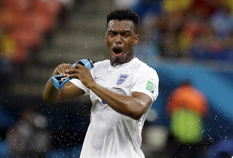 England's Daniel Sturridge douses himself down during the group D World Cup soccer match between England and Italy at the Arena da Amazonia in Manaus, Brazil, Saturday, June 14, 2014