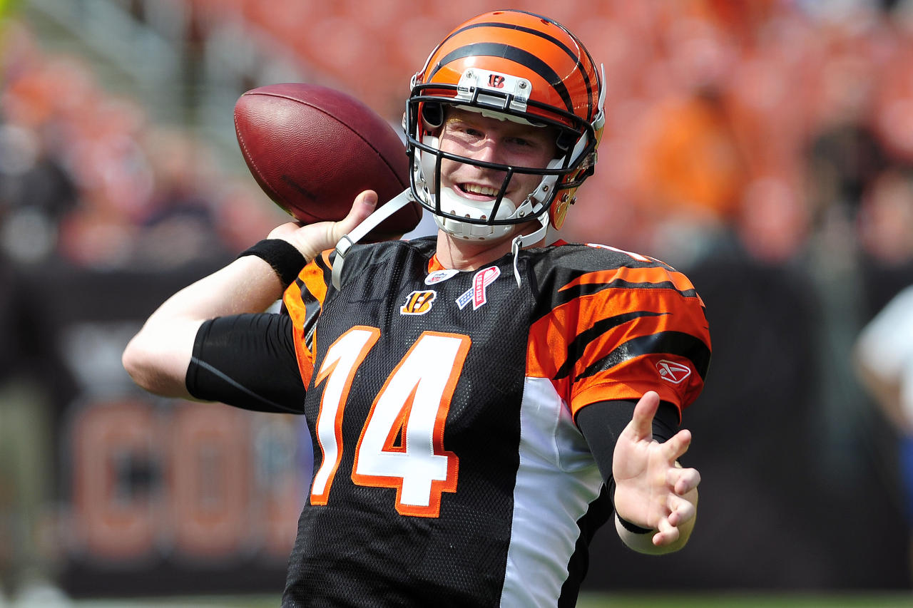 CLEVELAND, OH - SEPTEMBER 11: Starting quarterback Andy Dalton #14 of the Cincinnati Bengals warms up prior to the season opener against the Cleveland Browns at Cleveland Browns Stadium on September 11, 2011 in Cleveland, Ohio. (Photo by Jason Miller/Getty Images)