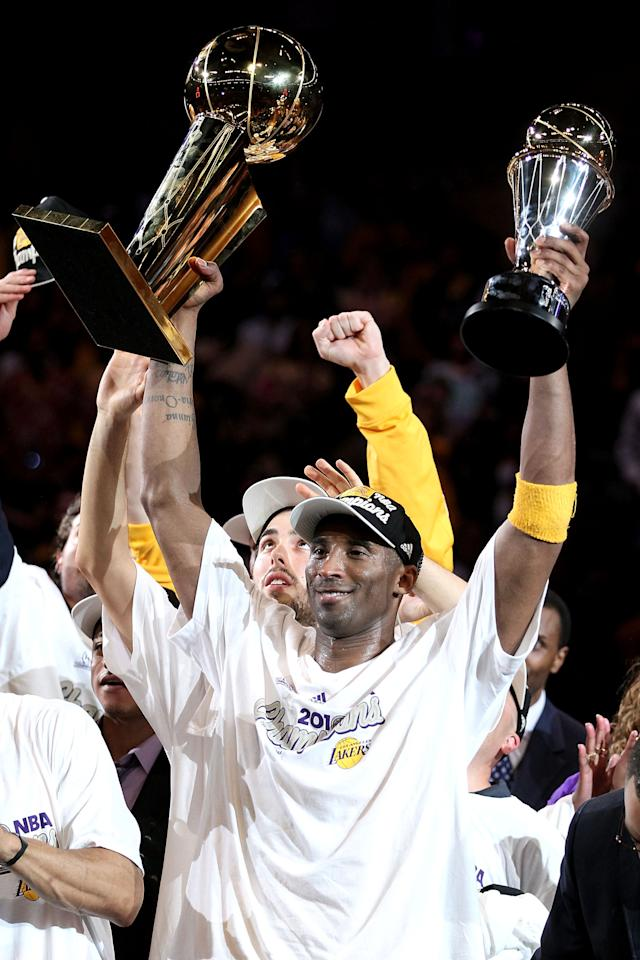 LOS ANGELES, CA - FILE:  Kobe Bryant #24 of the Los Angeles Lakers holds up the Larry O'Brien trophy and the MVP trophy after the Lakers defeated the Boston Celtics in Game Seven of the 2010 NBA Finals at Staples Center on June 17, 2010 in Los Angeles, California. According to reports on December 16, 2011, Vanessa Bryant has filed for divorce from her husband of over 10 years, Kobe Bryant.  NOTE TO USER: User expressly acknowledges and agrees that, by downloading and/or using this Photograph, user is consenting to the terms and conditions of the Getty Images License Agreement.  (Photo by Christian Petersen/Getty Images)