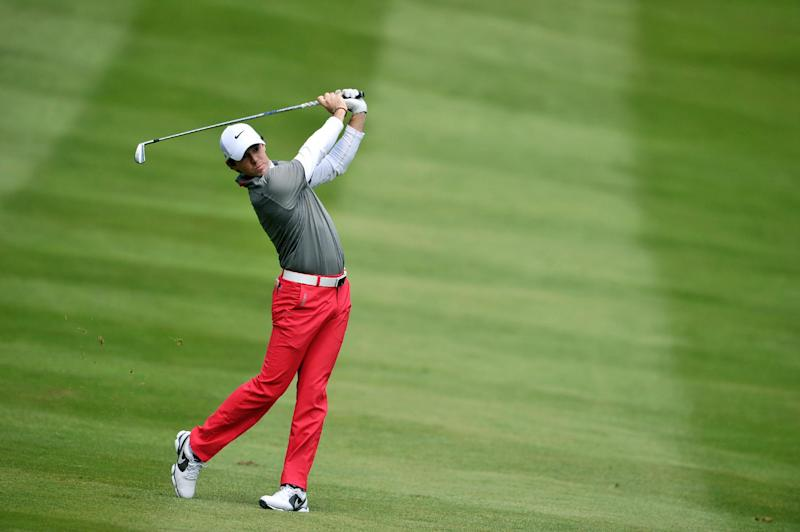 Northern Irish golfer Rory McIlroy plays his approach shot to the 4th green during the final round of the PGA Championship at Wentworth Golf Club in Surrey, England, on May 25, 2014