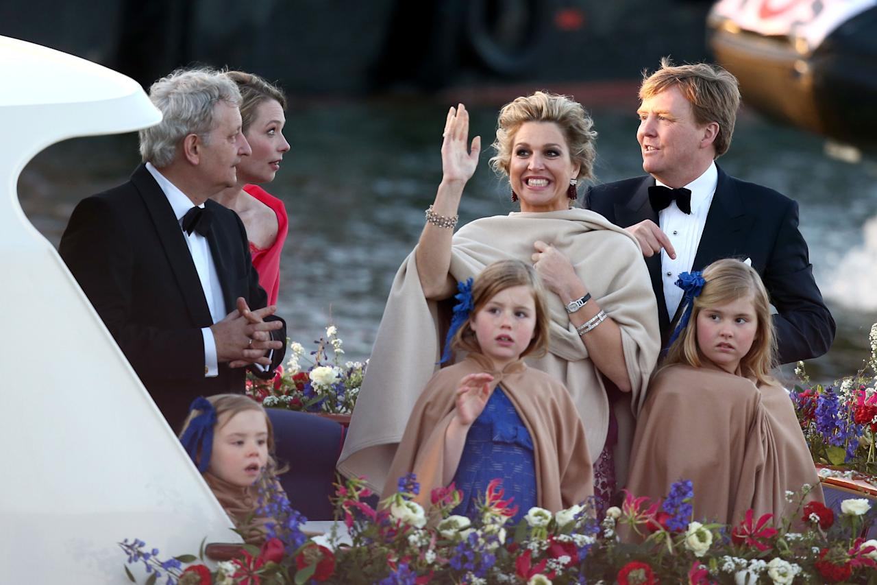 AMSTERDAM, NETHERLANDS - APRIL 30:  Queen Maxima (L) and King Willem Alexander (R) of The Netherlands with daughters Princess Alexia and Princess Catharina-Amalia are seen aboard the King's boat for the water pageant to celebrate the inauguration of King Willem Alexander of the Netherlands after the abdication of his mother Queen Beatrix of the Netherlands on April 30, 2013 in Amsterdam, Netherlands.  (Photo by Andreas Rentz/Getty Images)