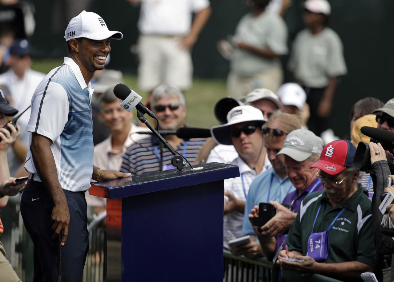 Tiger Woods speaks to the media during a news conference after a practice round for the PGA Championship golf tournament at Valhalla Golf Club on Wednesday, Aug. 6, 2014, in Louisville, Ky. The tournament is set to begin on Thursday. (AP Photo/John Locher)