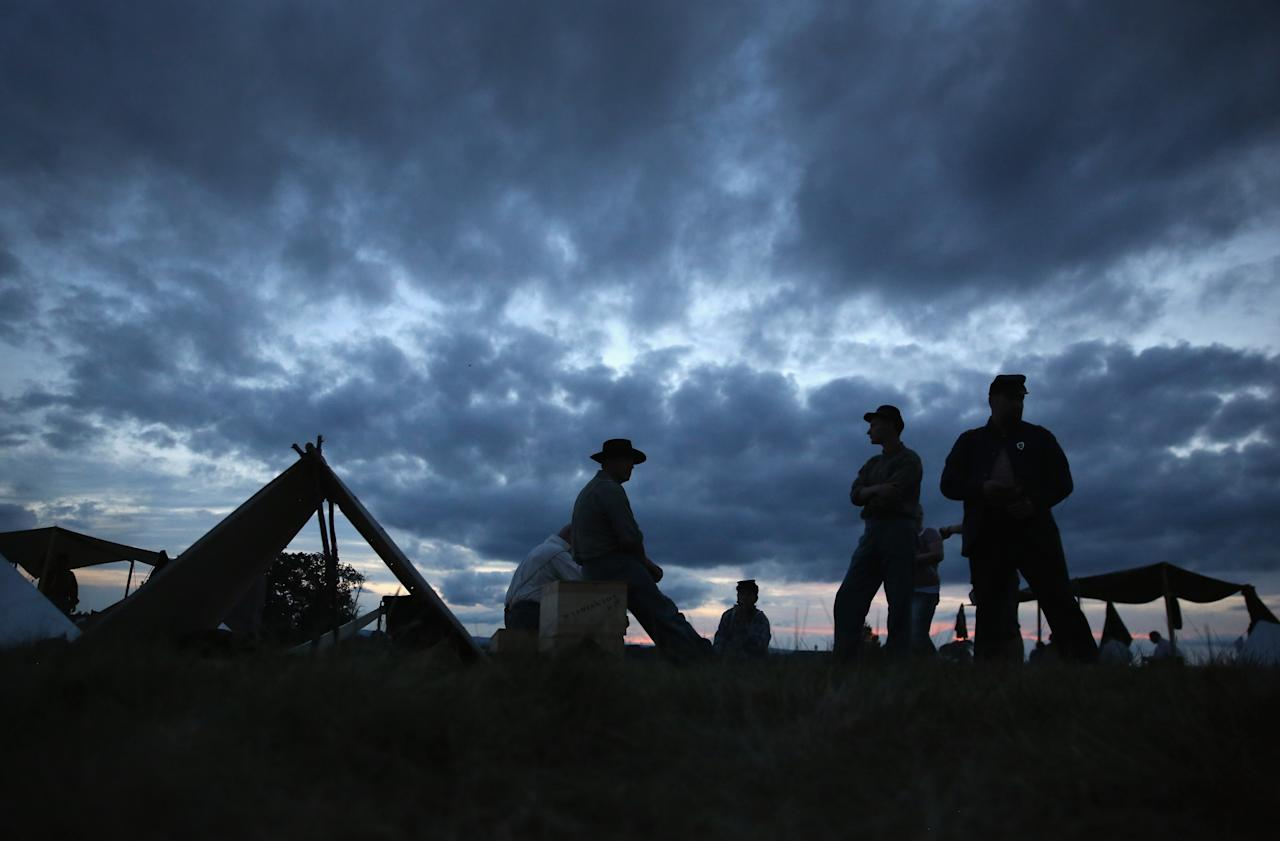 GETTYSBURG, PA - JULY 01: Union Civil War re-enactors await nightfall while camped at the Gettysburg National Military Park on the 150th anniversary of the historic battle on July 1, 2013 in Gettysburg, Pennsylvania. Thousands of Civil War soldiers are buried at the site, where, months later, Abraham Lincoln gave his Gettysburg Address. The battle is widely considered the turning point in the Civil War and a watershed moment in U.S. history. Union and Confederate armies suffered a combined total of up to 51,000 casualties over three days, the highest number of any battle in the four-year war. (Photo by John Moore/Getty Images)