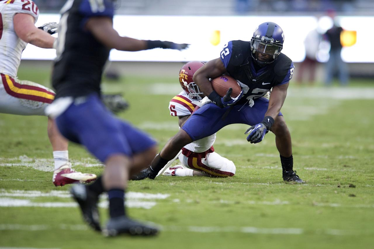 FORT WORTH, TX - OCTOBER 6:  Josh Boyce #82 of the TCU Horned Frogs tries to break a tackle during the Big 12 Conference game against the Iowa State Cyclones on October 6, 2012 at Amon G. Carter Stadium in Fort Worth, Texas.  (Photo by Cooper Neill/Getty Images)