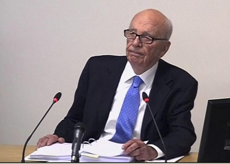 At inquiry, Rupert Murdoch defends 50-year record