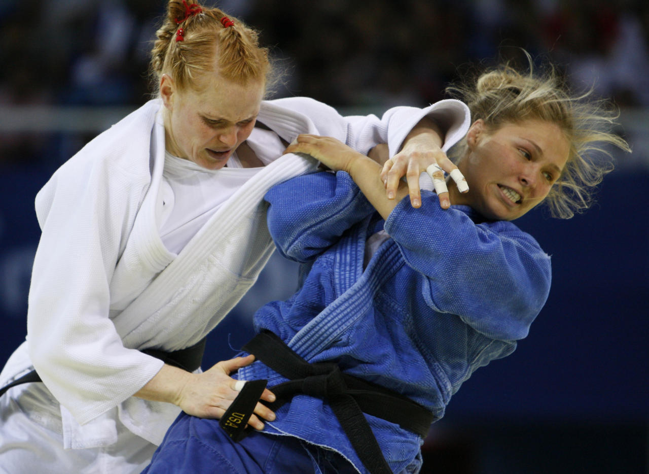 Ronda Rousey , right, from the United States battles with Annett Boehm of Germany during he women's judo -70kg middleweight division finals at the Beijing 2008 Olympics in Beijing, Wednesday, Aug. 13, 2008. USA won the bronze. (AP Photo/Charles Dharapak)